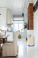 Elegant country-house-style kitchen with white wooden floor