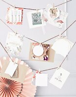 Greetings cards hung from cords by small clothes pegs