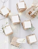 Small card boxes with white cards and ribbons