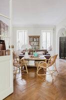 View through open double doors into living room with herringbone parquet floor