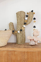 Paper garland on cactus ornament made from woven raffia