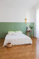 Two-tone painted wall in simple bedroom