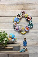Wreath made from photos framed in screw lids