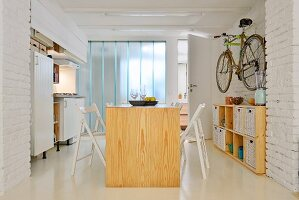 Kitchen in small industrial-style maisonette apartment