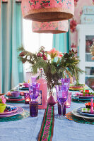 Table set with brightly coloured Oriental Christmas decorations