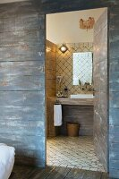Mediterranean bathroom behind rustic board wall