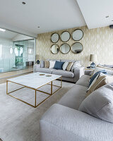 Glamorous living room in shades of Champagne with glass wall