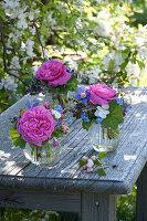 Small bouquets in glasses, rose, aquilegia, viola cornuta
