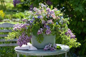 Spring arrangement from Syringa, Aquilegia, Myosotis