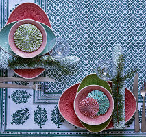 Patterned plates decorated with rosettes on set table
