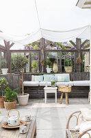 Summery veranda with half-open wall below awning