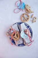 Peace-symbol biscuits and tags made from maps