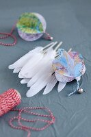 Bauble hand-made from map and white feathers
