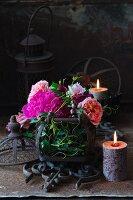 Pink peonies and salmon-pink roses in metal basket