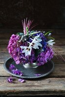 Purple arrangement of hydrangeas, Abyssinian sword-lilies and phylica