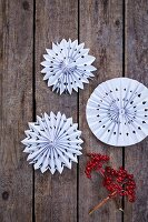 White paper rosettes on rustic wooden boards