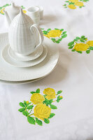 Tablecloth with iron-on floral motifs