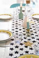 Star-patterned runner on festively set table
