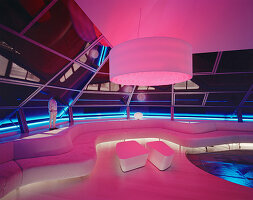 Futuristic living room illuminated in pink and blue