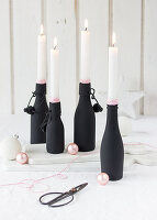 Hand-made Advent wreath made from black bottles