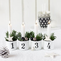 Hand-made Advent wreath in enamel mugs