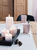 Homemade candles on a wooden tray