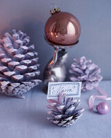 Christmas arrangement with pine cone used as place card holder