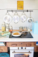 Rustic kitchen scene with pan of chanterelles, groceries and saucepans
