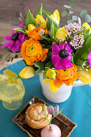 Spring bouquet of tulips, anemones, ranunculus and waxflowers