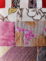 Detail of patchwork textile with various patterns