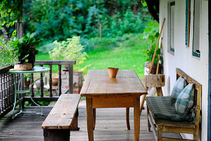 Wooden table and benches on veranda