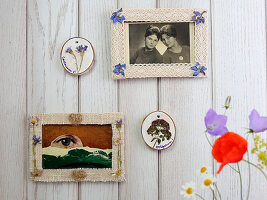 Picture frames decorated with pressed flowers and ribbon