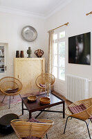 Round wicker chairs around low table in Mediterranean living room