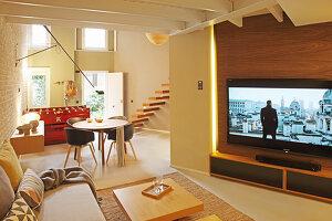 Large TV in open-plan interior with front door in background
