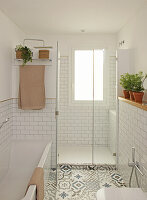 Large shower with window in bathroom with patterned floor