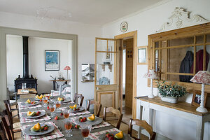 Table set with fruit in country-house-style dining room