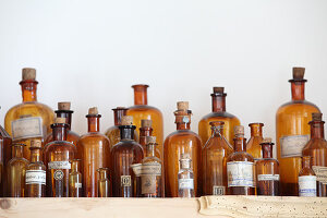 Apothecary bottles on wooden shelf