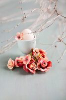 Roses, twigs and egg in eggcup