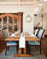 Set, rustic wooden table and upholstered chairs in dining area
