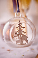 Stag and Christmas tree figurines in Christmas bauble