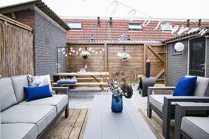 Upholstered outdoor furniture on wooden terrace