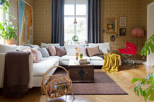 Vintage-style wallpaper and flea-market finds in living room