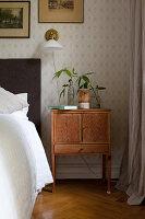 Old bedside cabinet in vintage-style bedroom