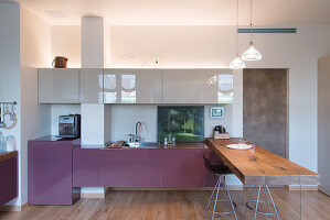 Designer kitchen with counter made from rustic wooden board