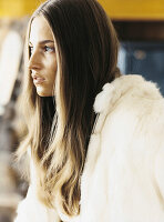 Young woman wearing off-white hooded jacket