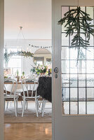 View through lattice doors into festively decorated dining room