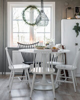 Windsor chairs painted black and white at dining room below window