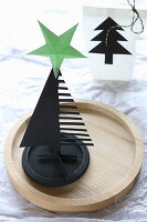 Black paper Christmas tree with green star on top