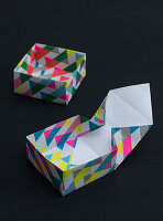 A square box made from wrapping paper