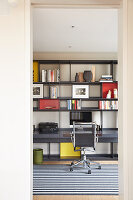Shelving with integrated desk in study
